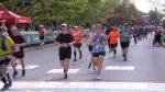 Runners cross the finish line of Ottawa Marathon May 26, 2019.