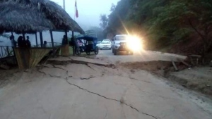 A road is left cracked after an earthquake in Peru