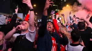 Toronto Raptors fans react after the team's 100-94 game six win over the Milwaukee Bucks to become the NBA Eastern Conference champions outside the Scotiabank Arena, in Toronto on Saturday, May 25, 2019. (THE CANADIAN PRESS/Chris Young)