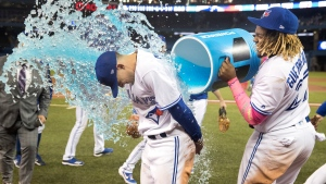 Toronto Blue Jays Cavan Biggio gets a Gatorade shower from teammate Vladimir Guerrero Jr. during a post-game interview after the Jays defeated the San Diego Padres 10-1 in their interleague MLB baseball game in Toronto, Sunday, May 26, 2019. (THE CANADIAN PRESS/Fred Thornhill)