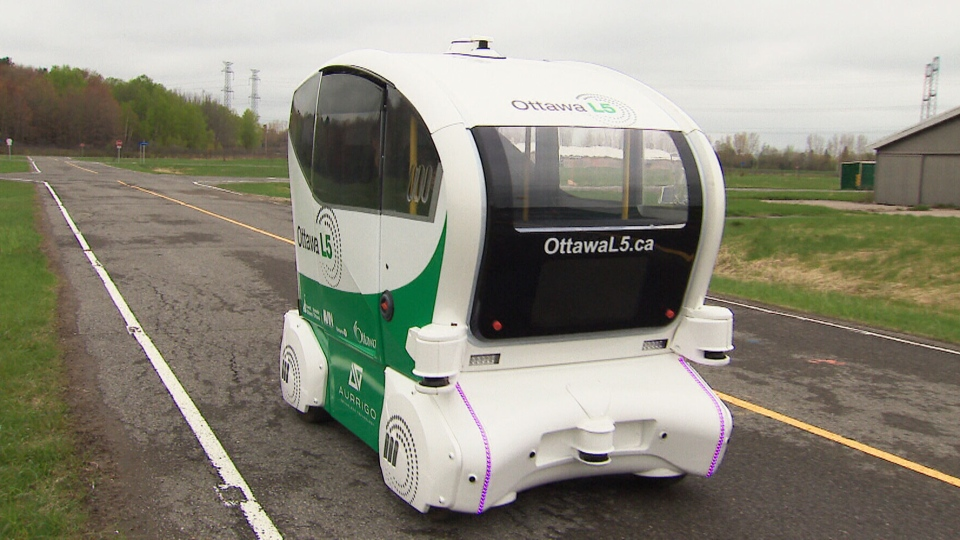 An autonomous vehicle bearing the Ottawa L5 logo takes a drive along the facility's private test course.
