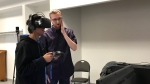 Fourteen-year-old Steven Gajahar tries out a new virtual reality game, that includes accessibility features for people with impaired vision.