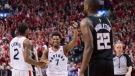 Toronto Raptors guard Kyle Lowry (7) reacts with teammate Kawhi Leonard (2) as Milwaukee Bucks forward Khris Middleton (22) looks on during the final seconds of the second half NBA Eastern Conference finals basketball action in Toronto on Saturday, May 25, 2019. THE CANADIAN PRESS/Nathan Denette