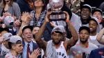 Toronto Raptors Kawhi Leonard hoists the trophy after the Raptors won theEastern Conference Final against the Milwaukee Bucks Toronto on Saturday, May 25, 2019. THE CANADIAN PRESS/Frank Gunn