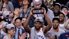 Toronto Raptors Kawhi Leonard hoists the trophy after the Raptors won theEastern Conference Final against the Milwaukee Bucks Toronto on Saturday, May 25, 2019. THE CANADIAN PRESS/Frank Gunn
