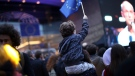 A young boy waves an EU flag as he watches a giant screen television outside the European Parliament in Brussels, Sunday, May 26, 2019. From Germany and France to Cyprus and Estonia, voters from 21 nations went to the polls Sunday in the final day of a crucial European Parliament election that could see major gains by the far-right, nationalist and populist movements that are on the rise across much of the continent. (AP Photo/Francisco Seco)