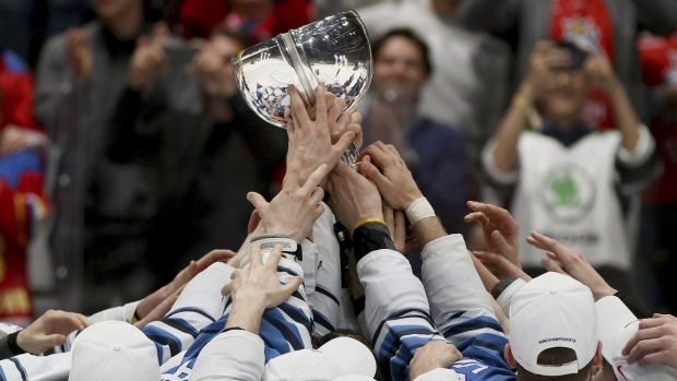Finland players celebrate with their trophy