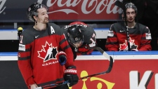 Canadians react as Finland players celebrate