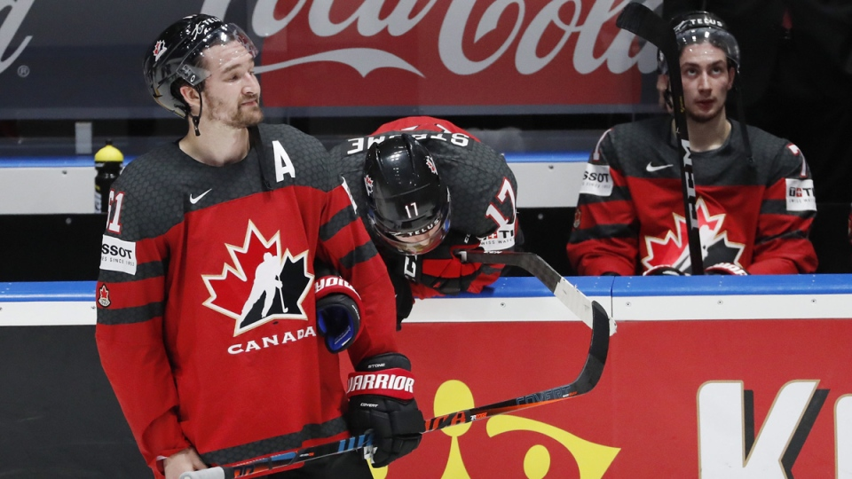Canada's Mark Stone (61) watches as Finland players celebrate after the Ice Hockey World Championships gold medal match on May 26, 2019. (Petr David Josek / AP)