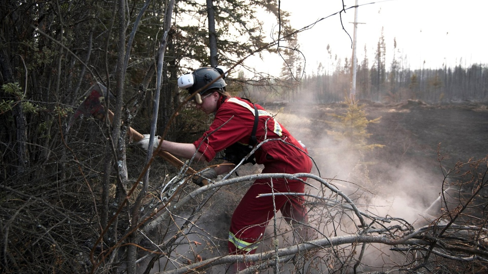Crews work to put out hot spots to reduce the spread of the Chuckegg Creek Fire near High Level, Alta. (Government of Alberta / Facebook)