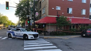 Montreal police investigated a shooting and robbery at a restaurant on Jean Talon at 13th Ave. in Montreal (CJAD/Elizabeth Zogalis)