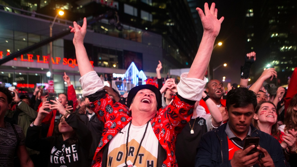 Toronto Raptors fans celebrate in the closing seconds of the team's 100-94 win over the Milwaukee Bucks to take the NBA Eastern Conference Championship, in Toronto on Saturday, May 25, 2019. (THE CANADIAN PRESS/Chris Young)