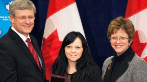 Human trafficking survivor Timea Nagy, centre, with former PM Stephen Harper and then cabinet minister Diane Finley. (CTV)