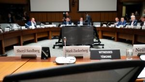 An empty chair sits behind the name tags for Facebook's Mark Zuckerberg and Sheryl Sandberg as the International Grand Committee on Big Data, Privacy and Democracy waits to begin in Ottawa, Tuesday May 28, 2019. THE CANADIAN PRESS/Adrian Wyld