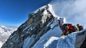 A photo taken by Nirmal Purja of Project Possible - who is aiming to climb all 14 of the world's 8,000 metre-plus peaks - shows heavy traffic of climbers lining up to summit Mount Everest. (AFP)