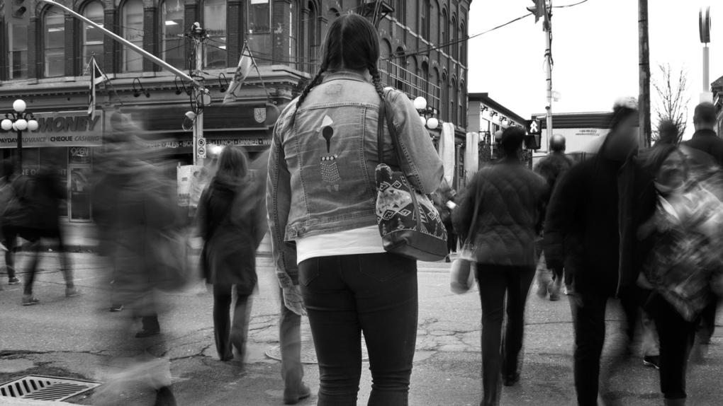 People cross a street