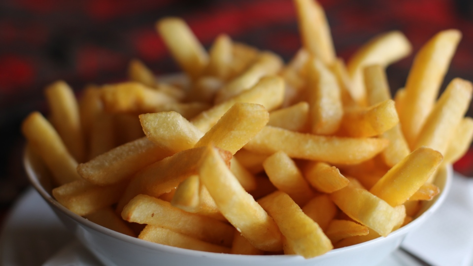 A new Spanish study says consuming four or more servings per day of ultra-processed foods such as fries, chips, cake and ice cream increases a person's risk of death by 62 per cent. (Dzenina Lukac / Pexels)
