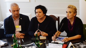 "FILE - In this Oct. 8, 2018 file photo, head of a Polish organization ""Have No Fear"", representing victims of pedophile priests, Marek Lisinski left, sits with activist Agata Diduszko-Zyglewska, center, and opposition lawmaker Joanna Scheuring-Wielgus during a meeting that demanded strict criminal punishment for pedophile priests at the parliament in Warsaw, Poland. (AP Photo/Czarek Sokolowski, file)"
