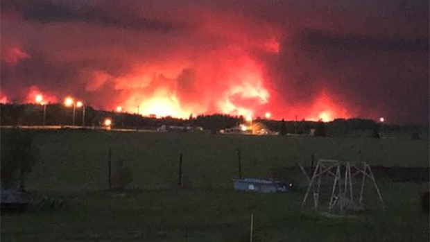 Fire encroaches on the Paddle Prairie Metis Settlement border in Alberta. (SOURCE: PETER MCGILLIVRAY)