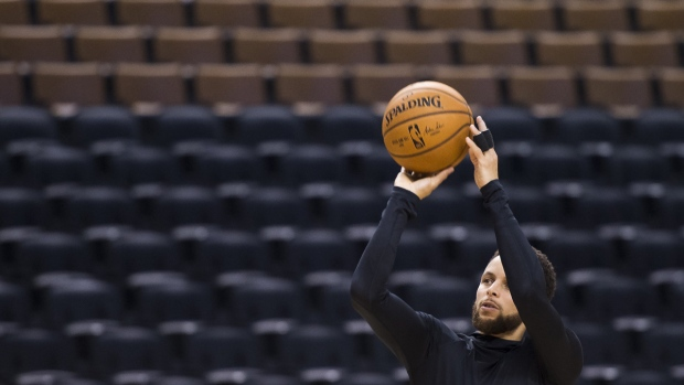 Stephen Curry shoots during practice