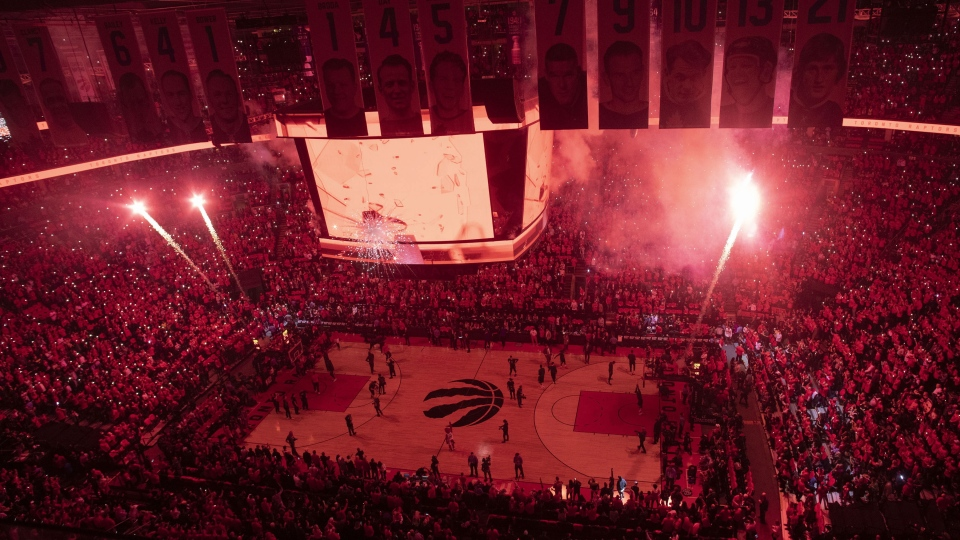Pyrotechnics illuminate the court before first half NBA Eastern Conference finals action between the Toronto Raptors and the Milwaukee Bucks, in Toronto on Saturday, May 25, 2019. THE CANADIAN PRESS/Chris Young
