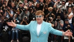 In this Thursday, May 16, 2019 photo, singer Elton John poses for photographers at the photo call for the film 'Rocketman' at the 72nd international film festival, Cannes, southern France. (Photo by Joel C Ryan/Invision/AP)