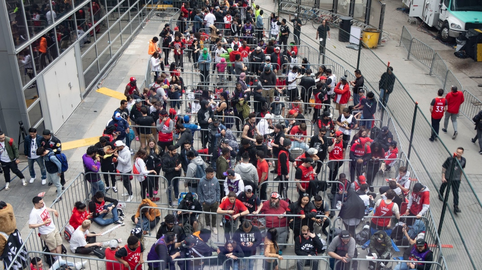 Toronto Raptors fans line up to get into the fan area known as