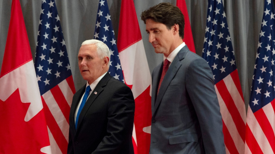 Prime Minister Justin Trudeau and U.S. Vice-President Mike Pence make their way to a joint news conference in Ottawa, Thursday, May 30, 2019. THE CANADIAN PRESS/Adrian Wyld