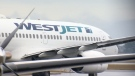 A WestJet plane on the runway.