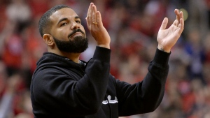 "Toronto-born performer Aubrey ""Drake"" Graham cheers from courtside during first half NBA Eastern Conference finals action between the Toronto Raptors and the Milwaukee Bucks, in Toronto on Saturday, May 25, 2019. (THE CANADIAN PRESS / Nathan Denette)"