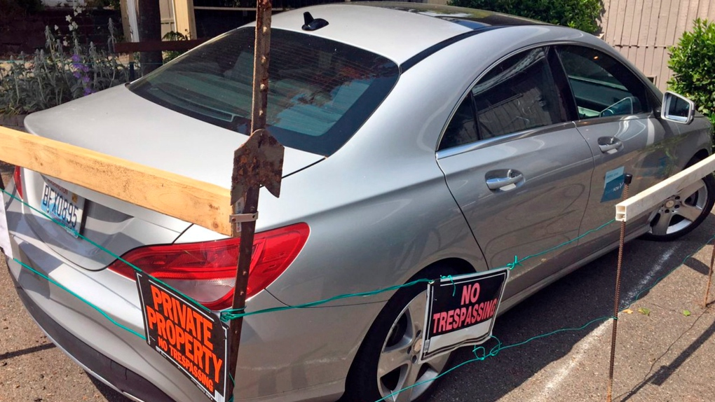 Man upset with car-sharing vehicle at his duplex builds