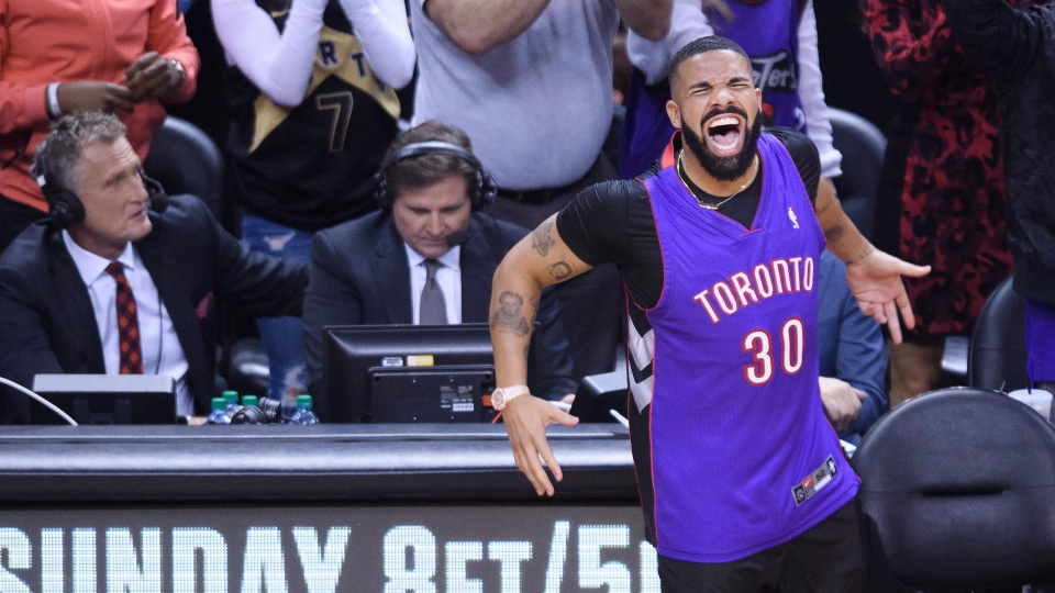Rapper Drake reacts court side as the Toronto Raptors play against the Golden State Warriors during first half basketball action in Game 1 of the NBA Finals in Toronto on Thursday, May 30, 2019. THE CANADIAN PRESS/Nathan Denette