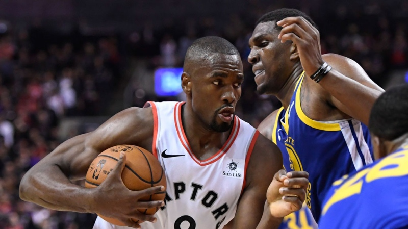 Toronto Raptors centre Serge Ibaka (9) holds the holds as Golden State Warriors centre Kevon Looney (5) defends during second half basketball action in Game 1 of the NBA Finals in Toronto on Thursday, May 30, 2019. (THE CANADIAN PRESS/Frank Gunn)