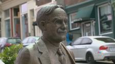 A statue of James Naismith, the inventor of basketball, sits on a bench in his birthplace of Almonte, Ont.