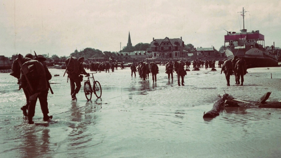 Canadian soldiers land on a Normandy, France beach during the D-Day invasion June 6, 1944. (THE CANADIAN PRESS/Department of National Defence)