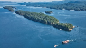A barge is seen passing through the Gulf Islands in late May 2019(Pete Cline / CTV News Vancouver)