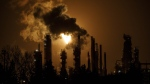 A flare stack lights the sky from the Imperial Oil refinery in Edmonton on December 28, 2018. THE CANADIAN PRESS/Jason Franson
