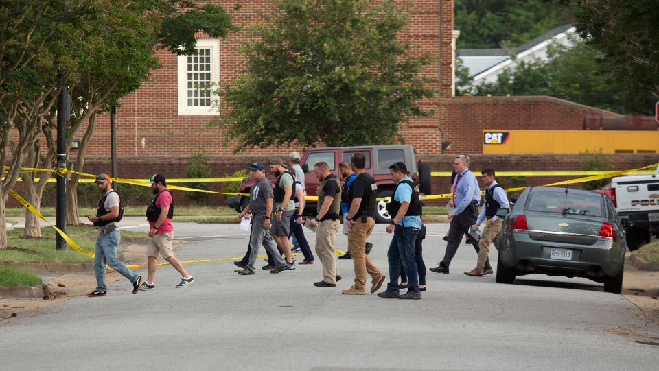 Police work the scene where eleven people were killed during a mass shooting at the Virginia Beach city public works building, Friday, May 31, 2019 in Virginia Beach, Va. (L. Todd Spencer/The Virginian-Pilot via AP)