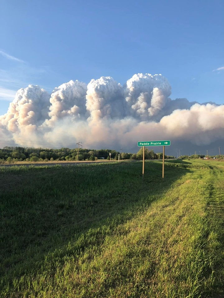 Smoke from wildfires are shown near Paddle Prairie, Alta in a handout photo provided by Pudgin Wanuch. THE CANADIAN PRESS/HO-Facebook-Pudgin Wanuch