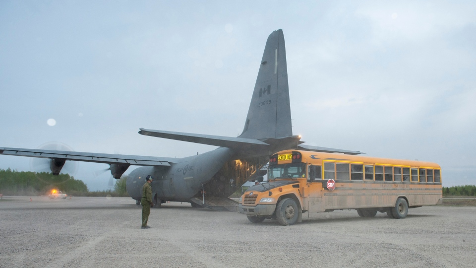 Members of the Canadian Armed Forces help evacuate people of Pikangikum First Nation in Northern Ontario, as part of operation LENTUS on Thursday, May 30, 2019. Evacuations continue in Pikangikum First Nation as a wildfire threatens the northern Ontario community. THE CANADIAN PRESS/HO-DND- LS Dan Bard 8 wing Imaging Trenton