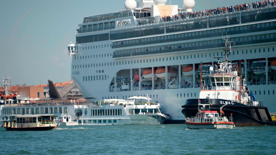 The MSC cruise ship Opera is seen after the collision with a tourist boat, in Venice, Italy, Sunday, June 2, 2019. The towering, out-of-control cruise ship rammed into a dock and a tourist river boat on a busy Venice canal on Sunday morning. (Andrea Merola/ANSA via AP)