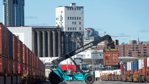 Shipping containers are moved at the Halterm Container Terminal in Halifax on Friday, Oct. 19, 2018. (THE CANADIAN PRESS/Andrew Vaughan)