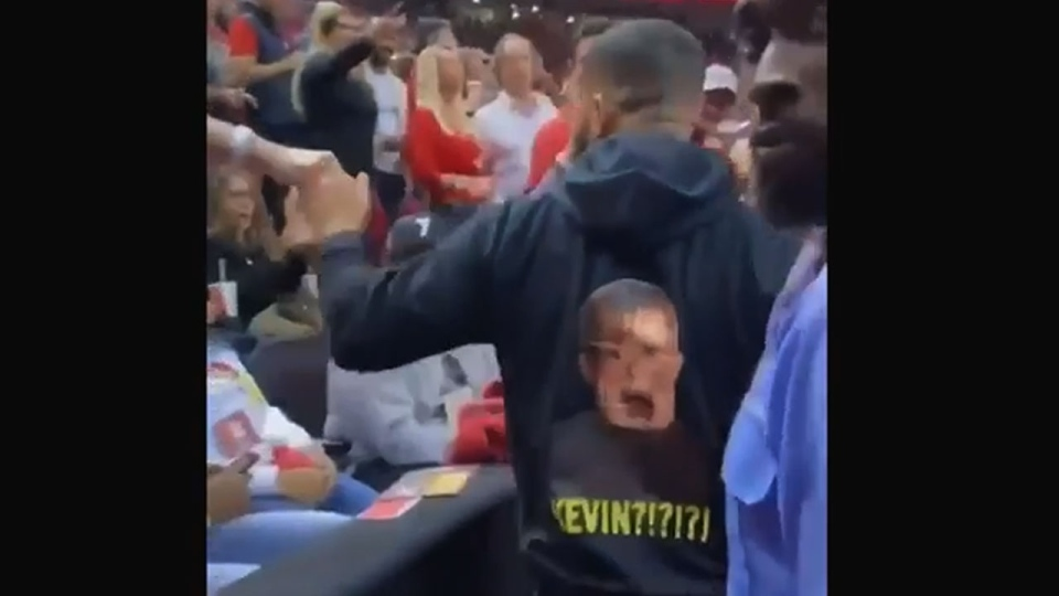 """Drake is seen wearing a black hoodie with a picture of actor Macaulay Culkin, who played Kevin McCallister in the """"Home Alone"""" movie franchise, mouth open and holding his face above the word """"Kevin?!?!?!"""" at Game 2 of the NBA Finals on Sunday June 2, 2019. (TSN)"""