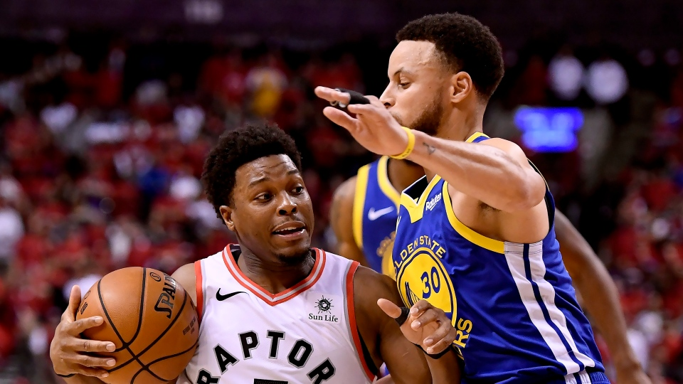 Golden State Warriors guard Stephen Curry (30) fouls Toronto Raptors guard Kyle Lowry (7) during second half Game 2 NBA Finals action, in Toronto on Sunday, June 2, 2019. THE CANADIAN PRESS/Frank Gunn