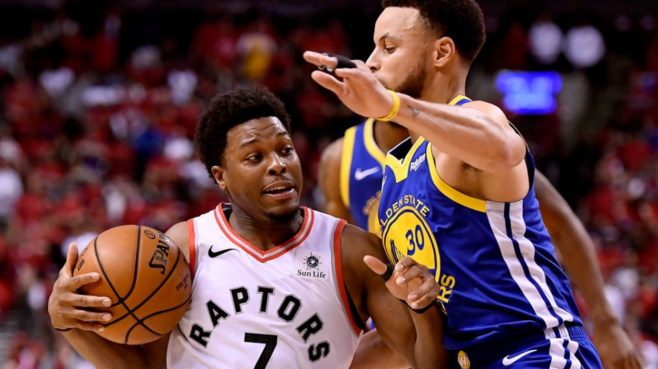 Golden State Warriors guard Stephen Curry (30) fouls Toronto Raptors guard Kyle Lowry (7) during second half Game 2 NBA Finals action, in Toronto on Sunday, June 2, 2019. (THE CANADIAN PRESS/Frank Gunn)