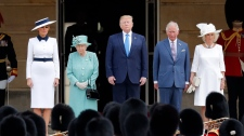 Trump greeted by royal family