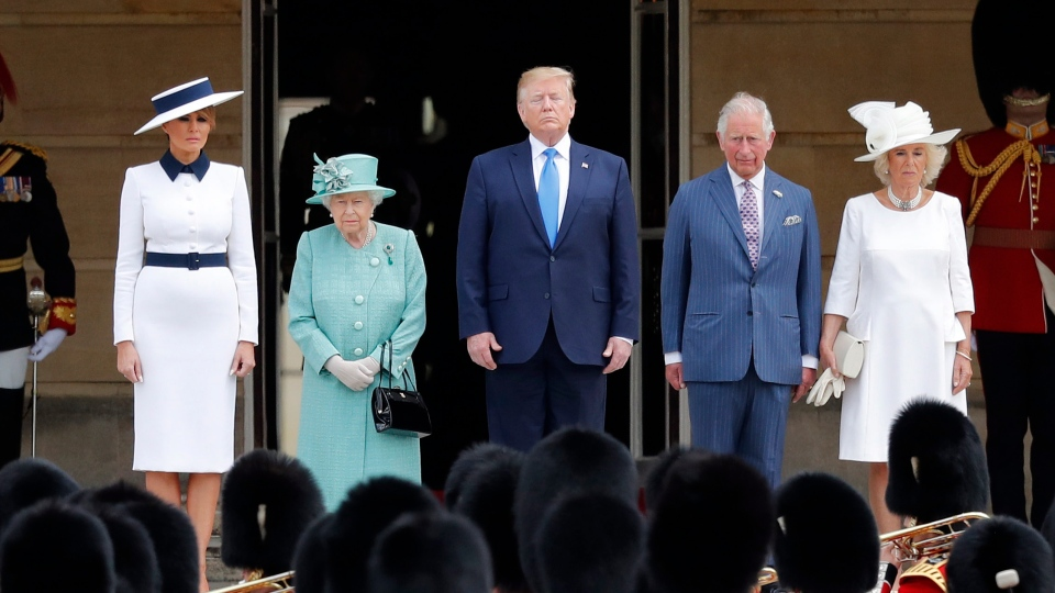 Queen Elizabeth II stands with President Donald Trump, center, and first lady Melania Trump, left, Britain's Prince Charles and Camilla, Duchess of Cornwall, right, during a ceremonial welcome in the garden of Buckingham Palace in London, Monday, June 3, 2019 on the opening day of a three day state visit to Britain. (AP Photo/Frank Augstein)