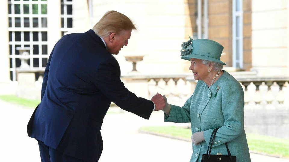 Queen Elizabeth II greets President Donald Trump as he arrives for a welcome ceremony in the garden of Buckingham Palace, in London, Monday, June 3, 2019.  (Victoria Jones/Pool via AP)