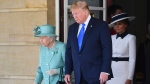 U.S President Donald Trump and First Lady Melania Trump attend a welcome ceremony with Queen Elizabeth in the garden of Buckingham Palace, in London, Monday, June 3, 2019. (Victoria Jones/Pool via AP)