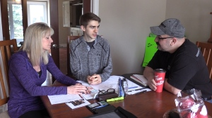 Brandan Barnett, center, along with his parents Lisa and Dan, are seen at their home in London, Ont. (Celine Moreau / CTV London)